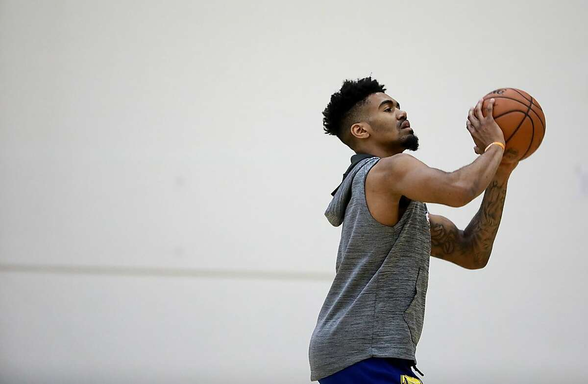 Golden State Warriors guard Jacob Evans practices his shooting during basketball practice at the Rakuten Performance Center in Oakland, Calif. on Wednesday, February 20, 2019.