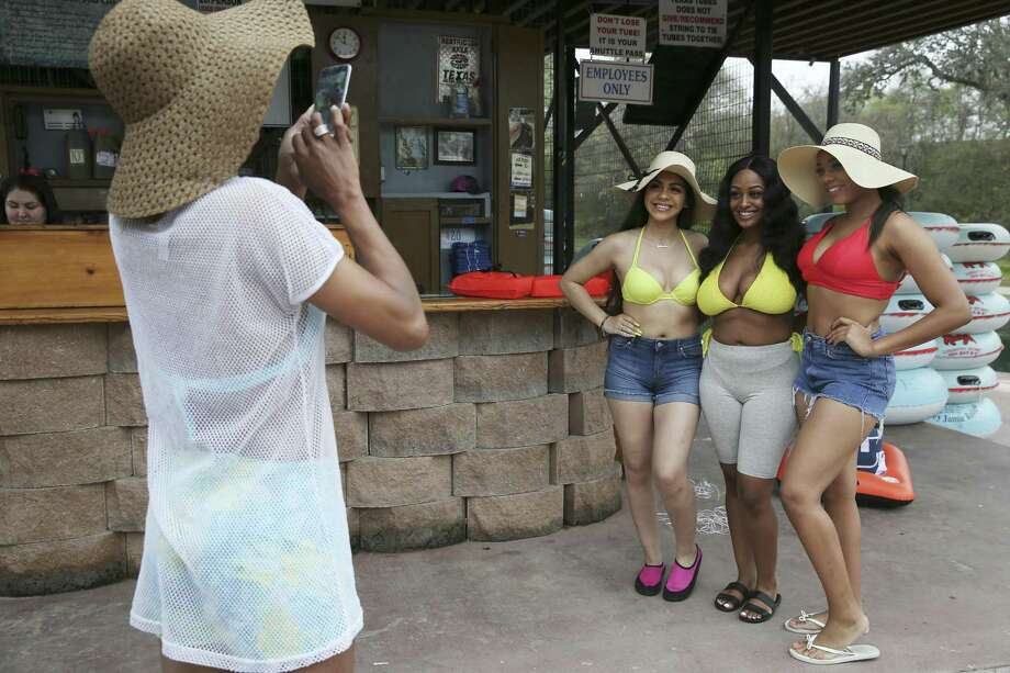 Carla Ford, 52, left, came with her clan — including from left, Johanna Toledo, 18, Negest Tsegaye, 18, and Carmen Ford, 17 — to Texas Tubes on the Comal River. Photo: Jerry Lara / Staff Photographer / © 2019 San Antonio Express-News