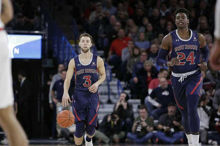 Jordan Ford (3), Malik Fitts and the rest of the St. Mary's Gaels take on San Diego in a WCC tournament semifinal at 8:30 p.m. Monday (ESPN2). Photo: Young Kwak / Associated Press