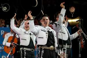Mariachi Real Del Valle cheers as the crowd votes during a mariachi contest at the Houston Livestock Show and Rodeo Sunday, March 10, 2019, in Houston.