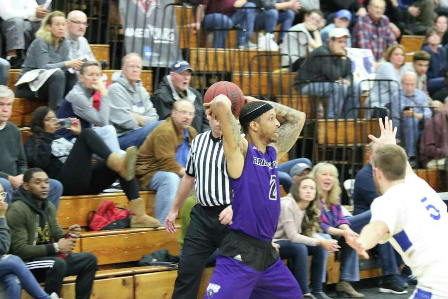 Bridgeport senior guard Dennis Green scored 19 points in a 90-86 loss to Malloy Sunday in the ECC tournament championship game at Harvey Hubbell Gym. Photo: University Of Bridgeport Athletics