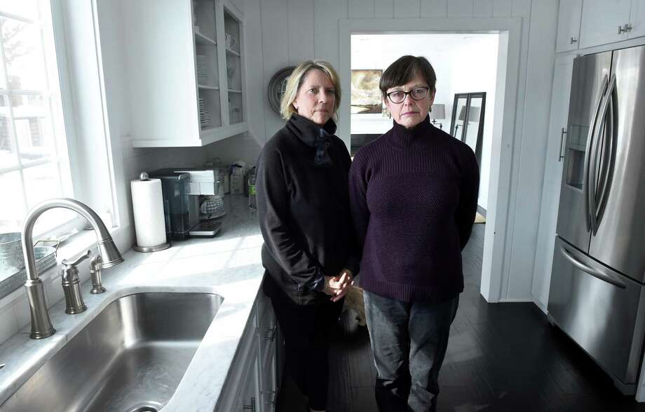 Sue Robins, left, and Melissa Dayton stand at Robins' home in the Mulberry Point section of Guilford on March 6. Dayton lives in Tuttle's Point. Both areas are having difficulties with well water. Photo: Arnold Gold / Hearst Connecticut Media / New Haven Register