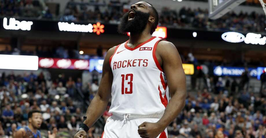 Houston Rockets guard James Harden (13) celebrates after sinking a basket and being fouled by Dallas Mavericks' Jalen Brunson, left rear, in the first half of an NBA basketball game in Dallas, Sunday, March 10, 2019. (AP Photo/Tony Gutierrez) Photo: Tony Gutierrez/Associated Press