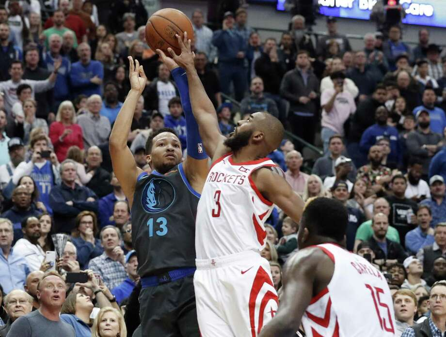 Dallas Mavericks guard Jalen Brunson (13) has his shot blocked by Houston Rockets guard Chris Paul (3) as Clint Capela (15) watches in the final seconds of an NBA basketball game in Dallas, Sunday. Photo: Tony Gutierrez, STF / Associated Press / Copyright 2019 The Associated Press. All rights reserved.