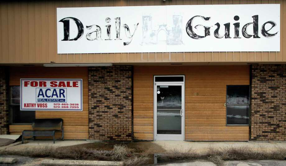 In this Feb. 19, 2019 photo, the old Daily Guide office stands for sale in St. Robert, Mo. With the shutdown of the newspaper in September 2018, this area in central Missouri's Ozark hills joined more than 1,400 other cities across the United States to lose a newspaper over the past 15 years, according to an Associated Press analysis of data compiled by the University North Carolina. (AP Photo/Orlin Wagner) Photo: Orlin Wagner / Copyright The Associated Press. All rights reserved