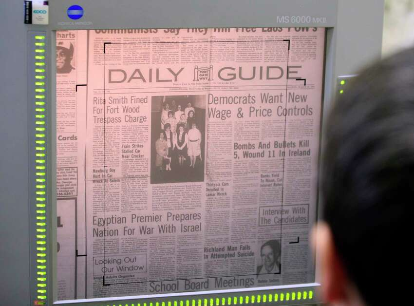 This Feb. 20, 2019 photo shows a microfilm copy of the Daily Guide at the library in Waynesville, Mo. With the shutdown of the Daily Guide in September 2018, this town of 5,200 people in central Missouri's Ozark hills joined more than 1,400 other cities across the United States to lose a newspaper over the past 15 years, according to an Associated Press analysis of data compiled by the University North Carolina. (AP Photo/Orlin Wagner)