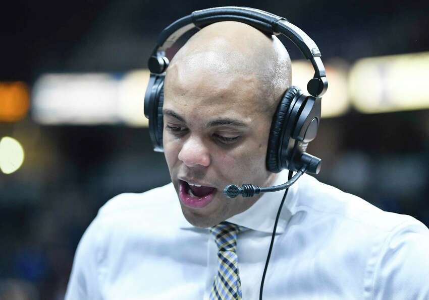 Siena Saints head coach Jamion Christian gives a radio interview after 73-57 loss to Iona after a Metro Atlantic Athletic Conference NCAA semifinal basketball game Sunday, March 10, 2019, in Albany, N.Y.
