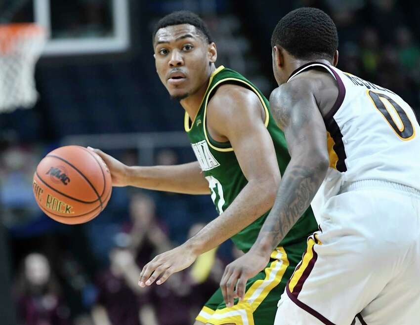 Siena Saints guard Jalen Pickett (22) moves the ball against Iona guard Rickey McGill (0) during a Metro Atlantic Athletic Conference NCAA semifinal basketball game Sunday, March 10, 2019, in Albany, N.Y. Iona won 73-57.