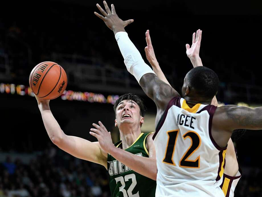 Siena Saints forward Evan Fisher (32) moves the ball against Iona forward Tajuan Agee (12) during a Metro Atlantic Athletic Conference NCAA semifinal basketball game Sunday, March 10, 2019, in Albany, N.Y. Iona won 73-57. Photo: Hans Pennink, Times Union / Hans Pennink