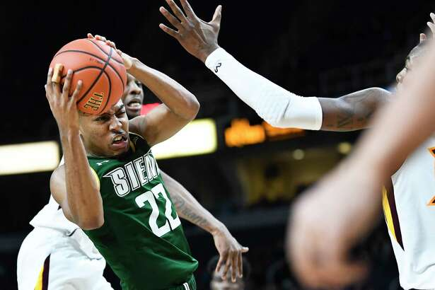 Siena Saints guard Jalen Pickett (22) moves the ball against Iona during a Metro Atlantic Athletic Conference NCAA semifinal basketball game Sunday, March 10, 2019, in Albany, N.Y. Iona won 73-57.
