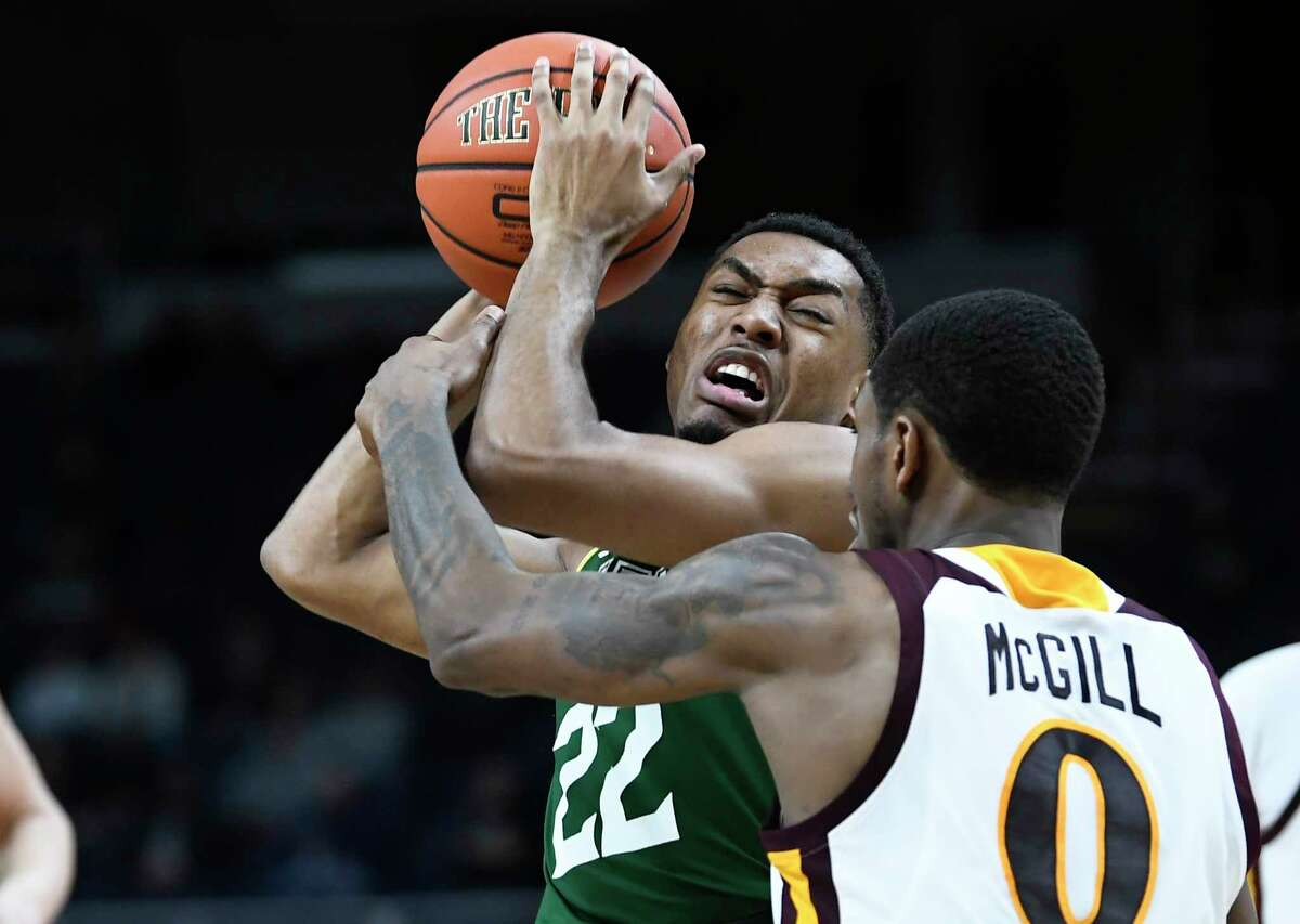 Siena Saints guard Jalen Pickett (22) is defended by Iona guard Rickey McGill (0) during a Metro Atlantic Athletic Conference NCAA semifinal basketball game Sunday, March 10, 2019, in Albany, N.Y. Iona won 73-57.