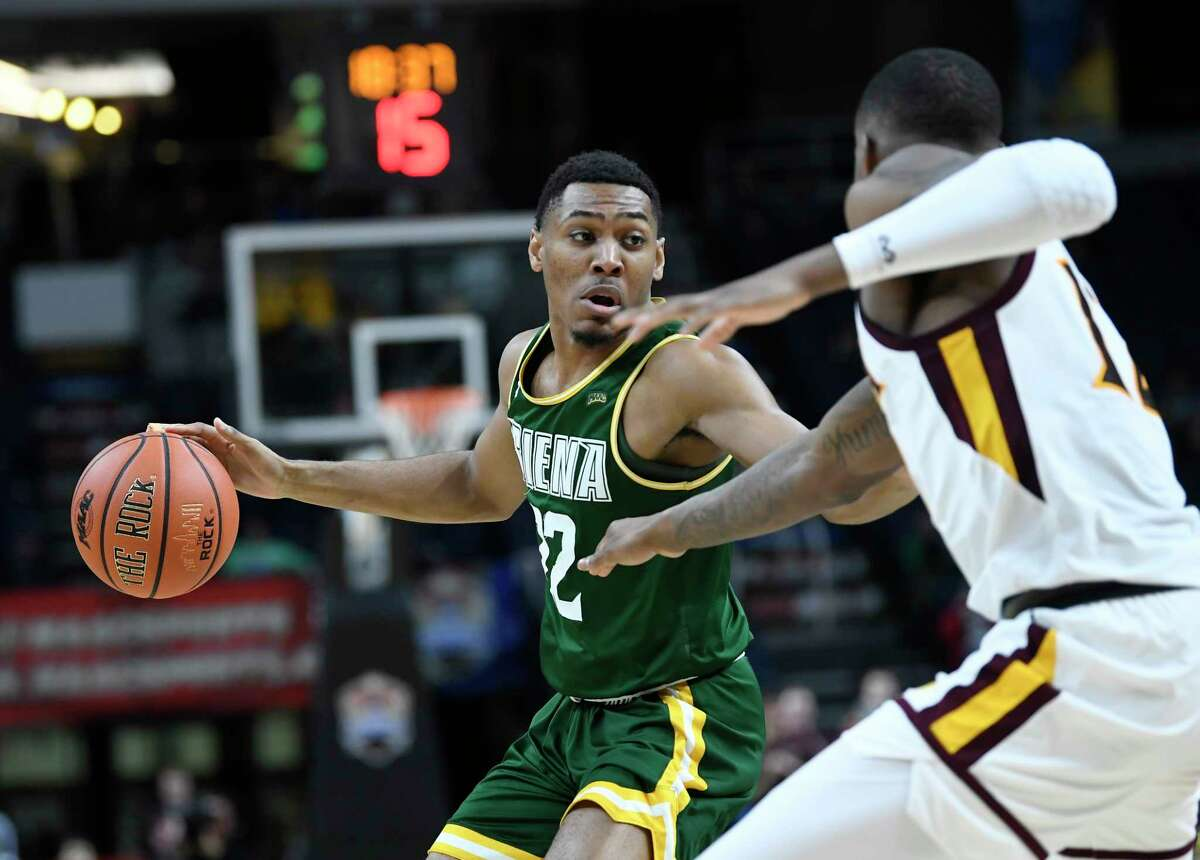 Siena Saints guard Jalen Pickett (22) is defended by Iona forward Tajuan Agee (12) during a Metro Atlantic Athletic Conference NCAA semifinal basketball game Sunday, March 10, 2019, in Albany, N.Y. Iona won 73-57.