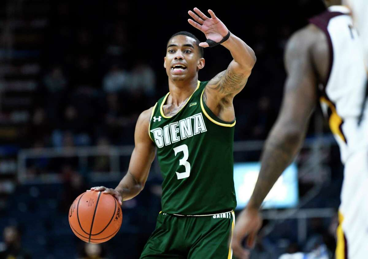 Siena Saints guard Manny Camper (3) moves the ball against Iona during a Metro Atlantic Athletic Conference NCAA semifinal basketball game Sunday, March 10, 2019, in Albany, N.Y. Iona won 73-57.