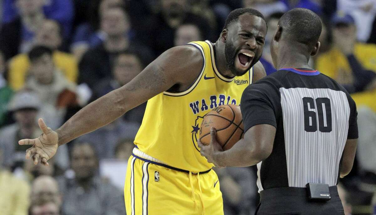 Warriors forward Draymond Green (23) debates a foul call against him with referee James Williams. Green had six points, 11 rebounds and eight assists in the game.