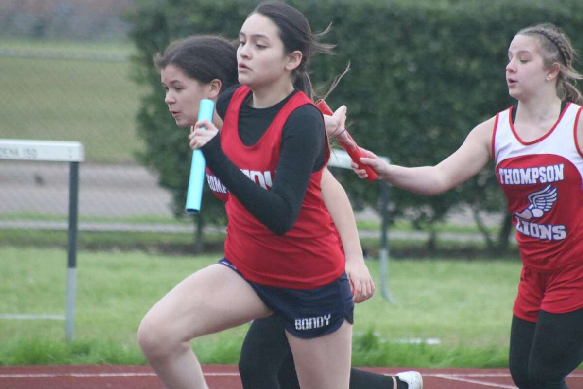 A Bondy Intermediate runner takes off with the baton just ahead of Thompson Intermediate's handoff during one of the relay races at the district championship meet. Bondy defeated Thompson for the eighth-grade title and it was Bondy, Miller, Thompson in the seventh-grade standings.