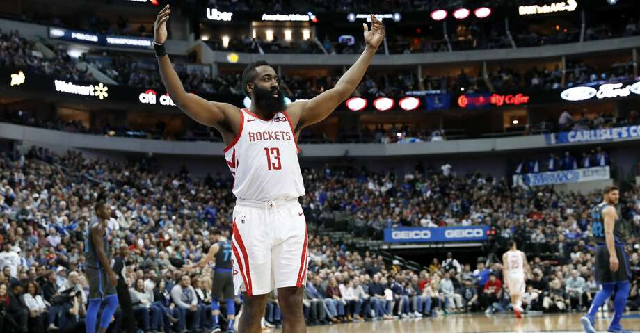 Houston Rockets guard James Harden (13) gestures to fans as they boo and cheer after the Rockets scored in the second half of an NBA basketball game against the Dallas Mavericks in Dallas, Sunday, March 10, 2019. (AP Photo/Tony Gutierrez) Photo: Tony Gutierrez/Associated Press