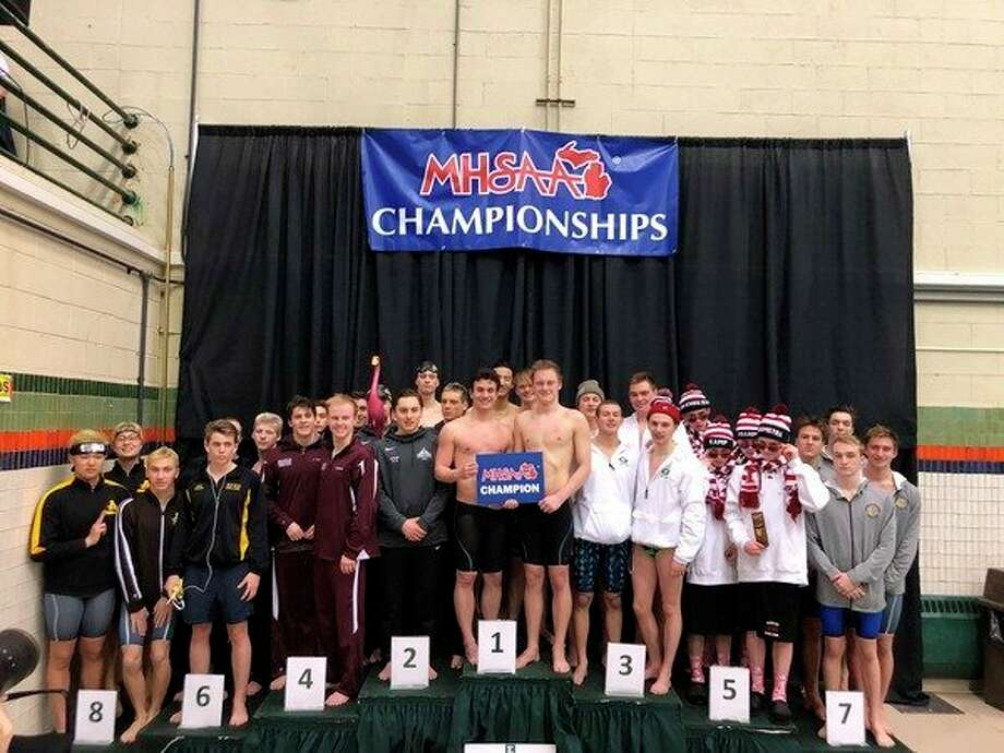 Standing in the first-place position on the podium for the 200-yard freestyle relay are Dow High's Hans Dehn (front left), Zach Fewkes (front right), Collin Che (back left) and Luke Lezotte (back right). (Photo provided)