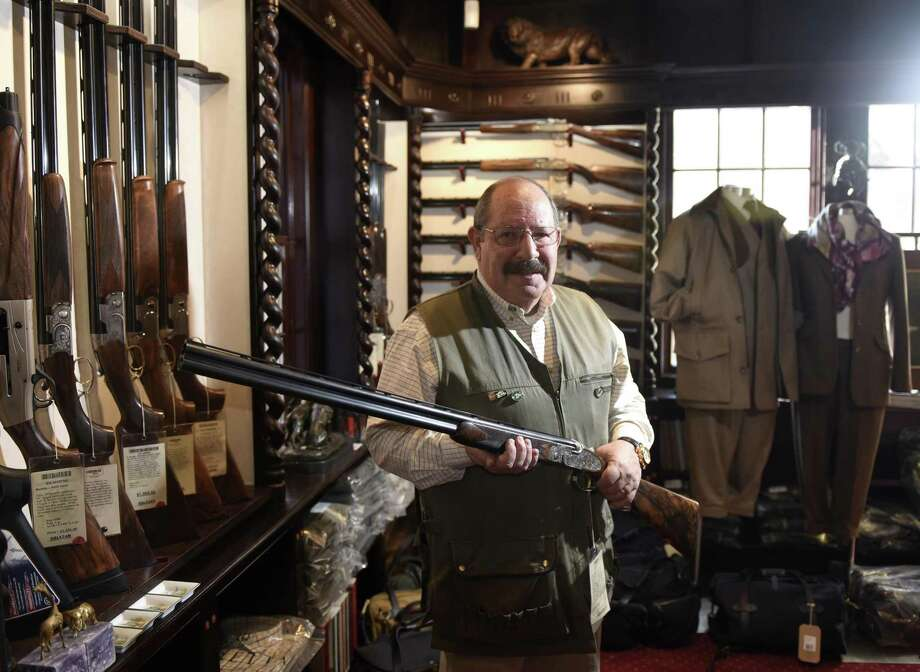 Store manager Alan Clair with a special order A-10 shotgun at Galazan Gunmakers in Greenwich on Feb. 28. Glazan Gunmakers is a manufacturer of custom, high-end shotguns, rifles and pistols and its Greenwich showroom is celebrating its fifth anniversary in March. The guns are handmade in a factory in New Britain with customizable attributes including size, wood type, engravings and more. Photo: Tyler Sizemore / Hearst Connecticut Media / Greenwich Time