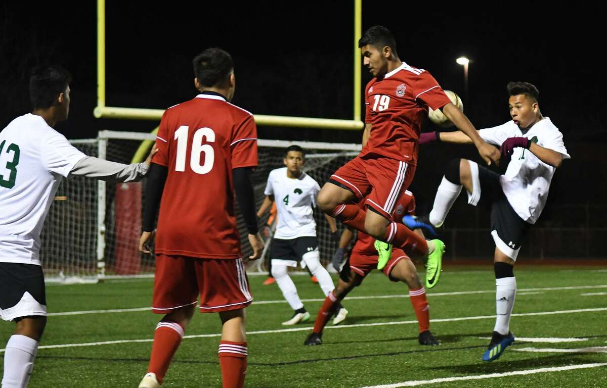 Westfield junior midfielder Javier Alarcon (19) turns his back on Spring defender (#11), right, to block a kick during their match at Westfield High School on Jan. 29, 2019.