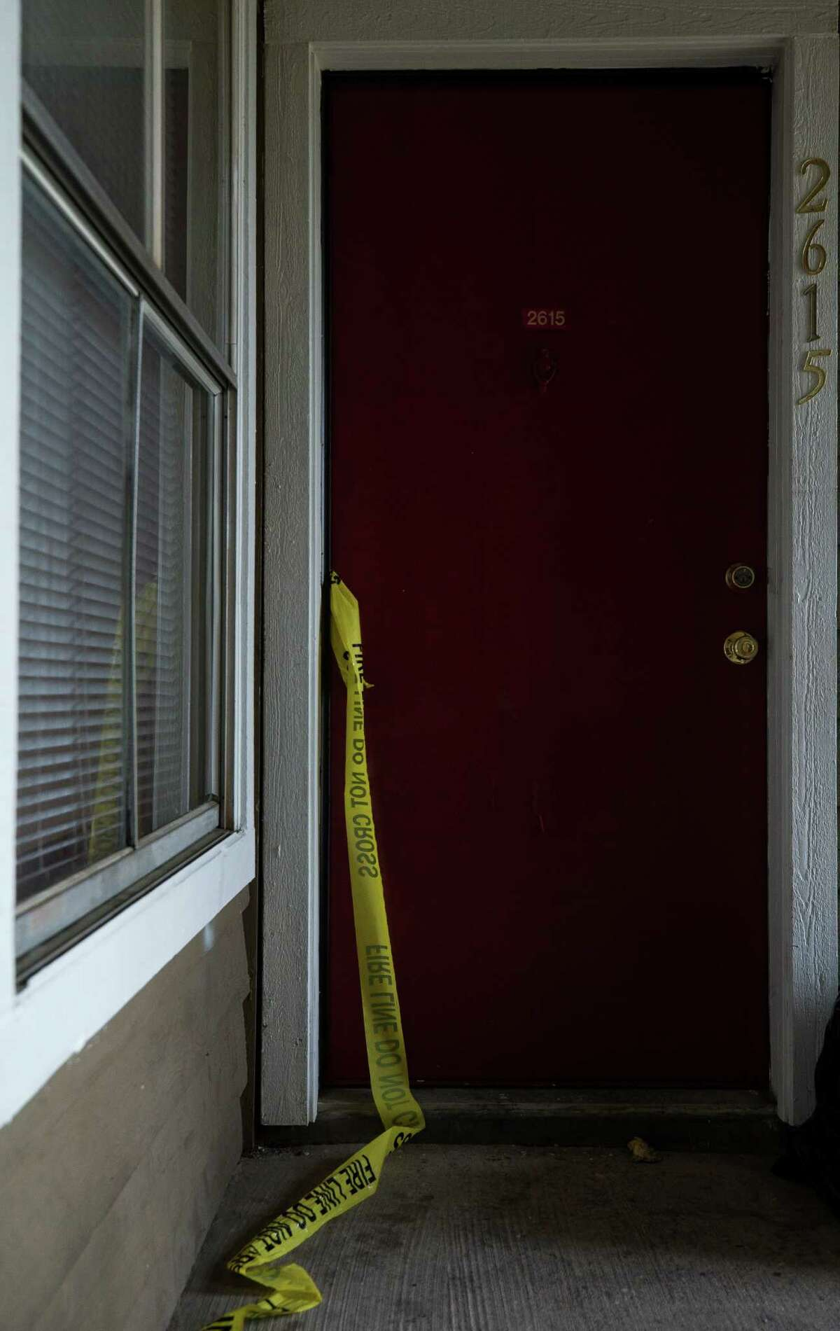 Crime tape left at the scene of a fire at the Cozumel Apartments complex Monday, March 11, 2019. A three-year-old boy died in the fire.