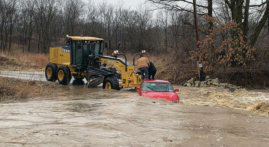 Shortly after a woman was pulled from her car, which was stuck in a flooded creek, the vehicle was pushed farther downstream by the force of the rising water. Photo: Pike County Sheriff's Department