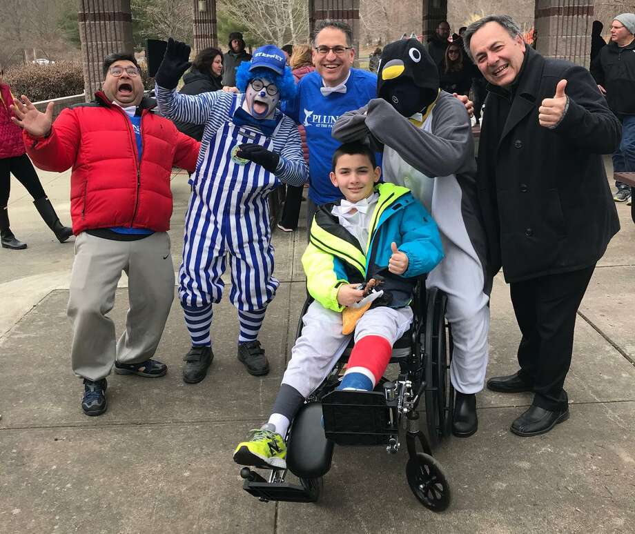 Monroe First Selectman Ken Kellog, center, poses with participants of the the Monroe Police Department's 8th annual Penguin Plunge at the Park at Great Hollow Lake in Monroe, Conn. on Saturday, April 7, 2018. The 2019 Plunge at the Park takes place April 6 at Great Hollow Lake. Photo: Contributed Photo / Contributed Photo / Connecticut Post Contributed