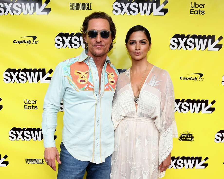 "Matthew McConaughey (L) and Camila Alves attend the premiere of ""The Beach Bum"" at the Paramount Theatre during the SXSW Conference And Festival on March 9, 2019 in Austin, Texas. Photo: Gary Miller/FilmMagic"