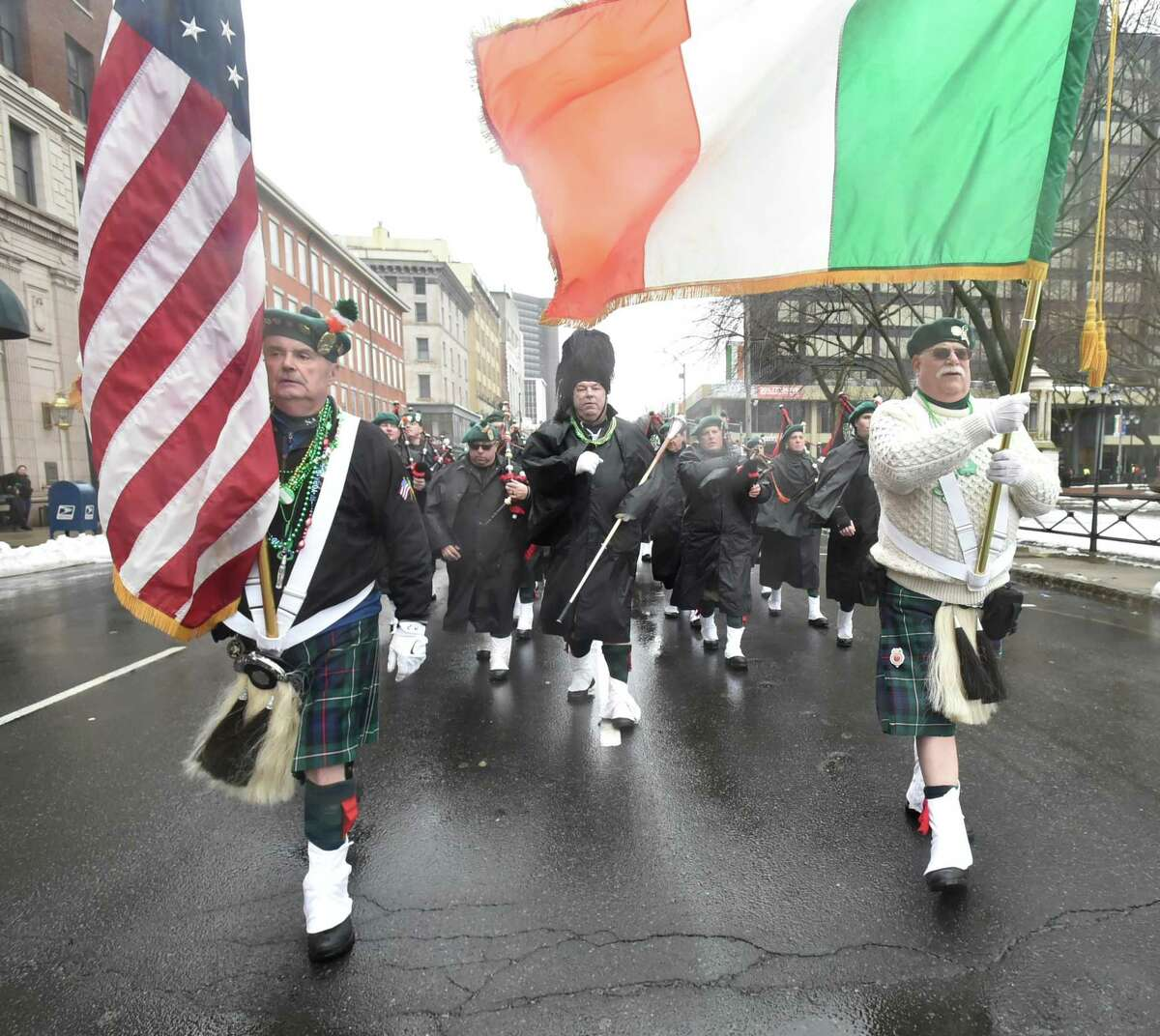 New Haven, Connecticut - Sunday, March 10, 2019: The St. Patrick?•s Day Parade on a rainy and chilly Sunday afternoon in New Haven. According to the St. Patrick's Day Parade of New Haven website, the parade tradition was born in New Haven on March 17, 1842, when about 90 members of the Hibernian Provident Society, a mutual aid organization formed the previous year, marched through the city streets behind a banner made especially for the occasion.