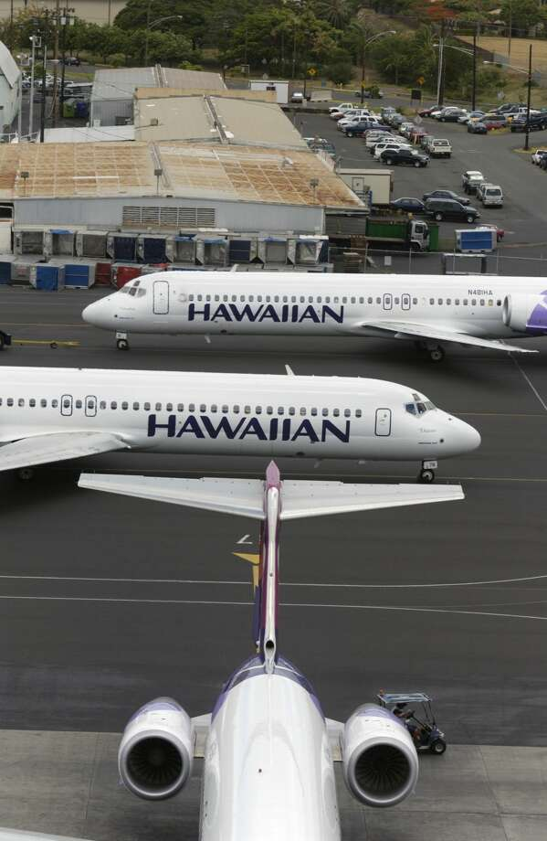 FILE PHOTO: Three Hawaiian Air Boeing 717-200's at Honolulu International airport. Photo: Aviation-images.com/UIG Via Getty Images