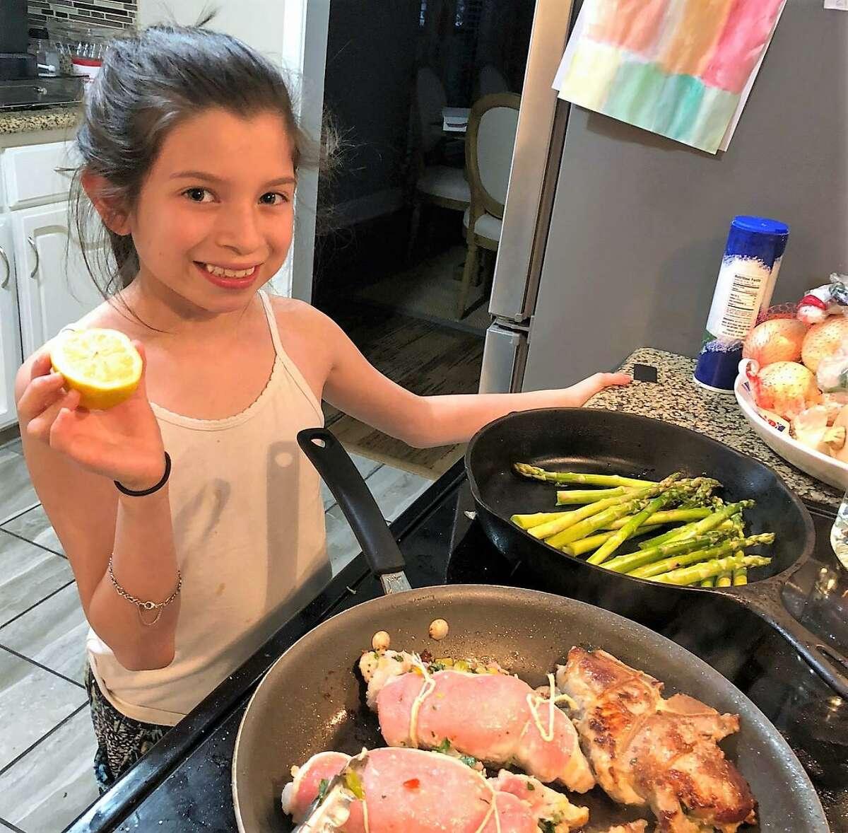 S.A. contestant Nayeli Mendoza prepares stuffed pork chops.