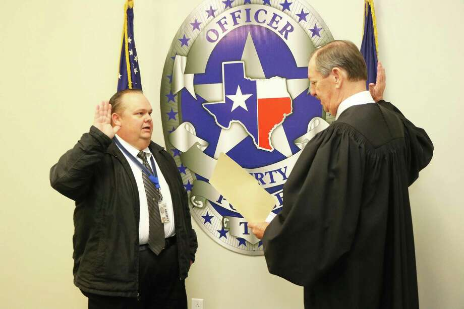 Gary Martin was sworn in as new police chief fulfilling a life-long dream and aspiration. He is sworn in by Liberty Municipal Court Judge Mike Little. Photo: David Taylor / Staff Photo