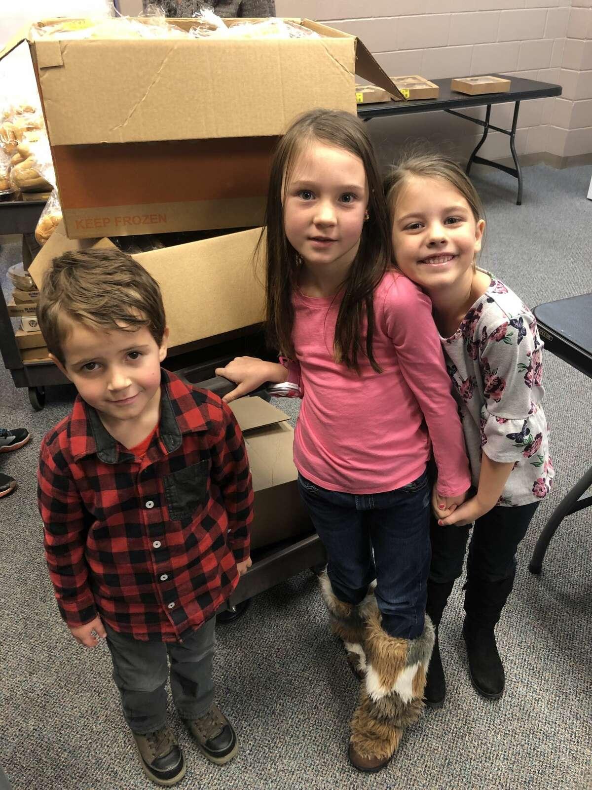 Food pantry: Noah Aldrin, from left, Kenley Green and Emma Horner