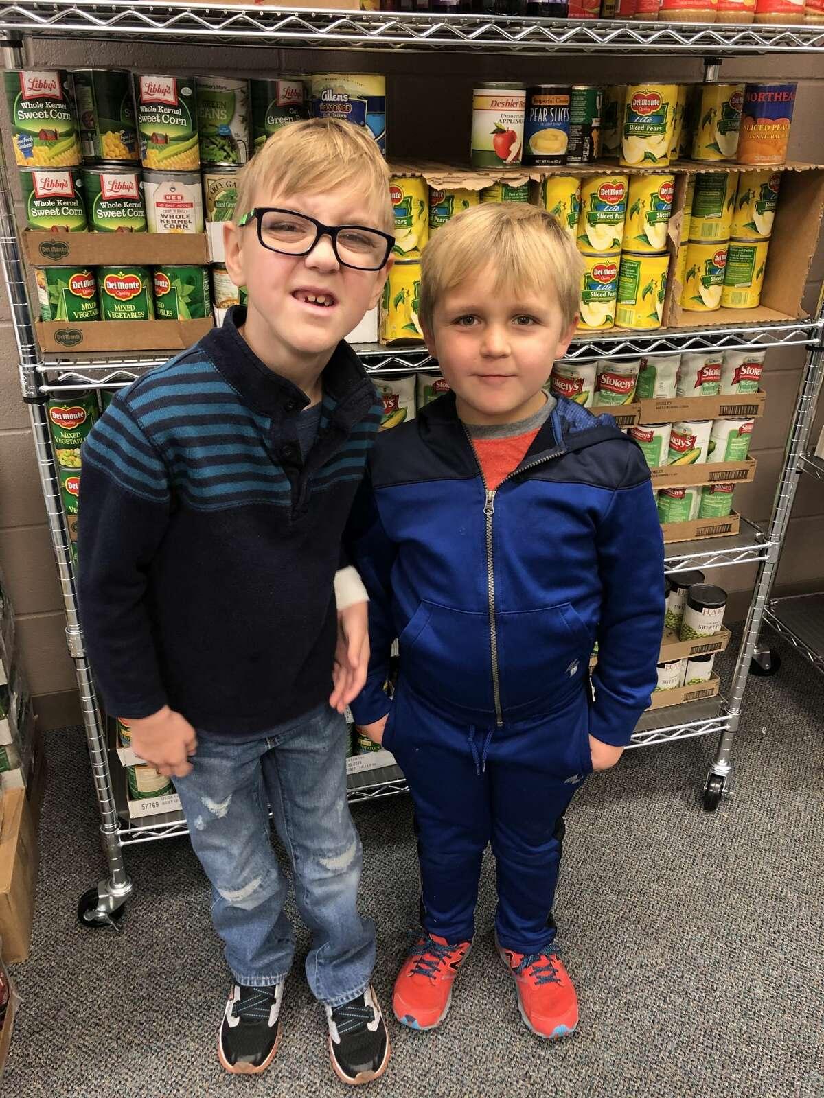 Food pantry: Kian Thoma, left, and Liam Nathan
