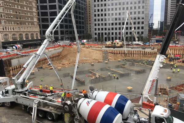 Concrete fills the foundation at Texas Tower on Sunday, March 10, 2019, in downtown Houston. Concrete trucks were unloaded every 45 seconds for 20 hours for the mat foundation for the building, which will rise more than 700 feet tall.