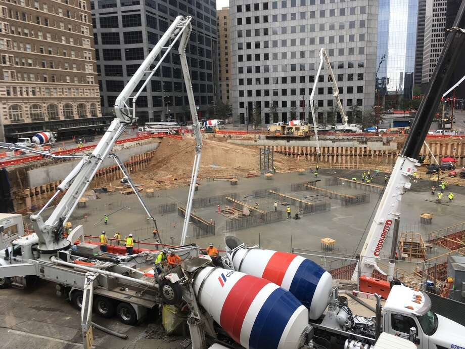 Concrete fills the foundation at Texas Tower on Sunday, March 10, 2019, in downtown Houston. Concrete trucks were unloaded every 45 seconds for 20 hours for the mat foundation for the building, which will rise more than 700 feet tall. Photo: Katherine Feser  /  Houston Chronicle