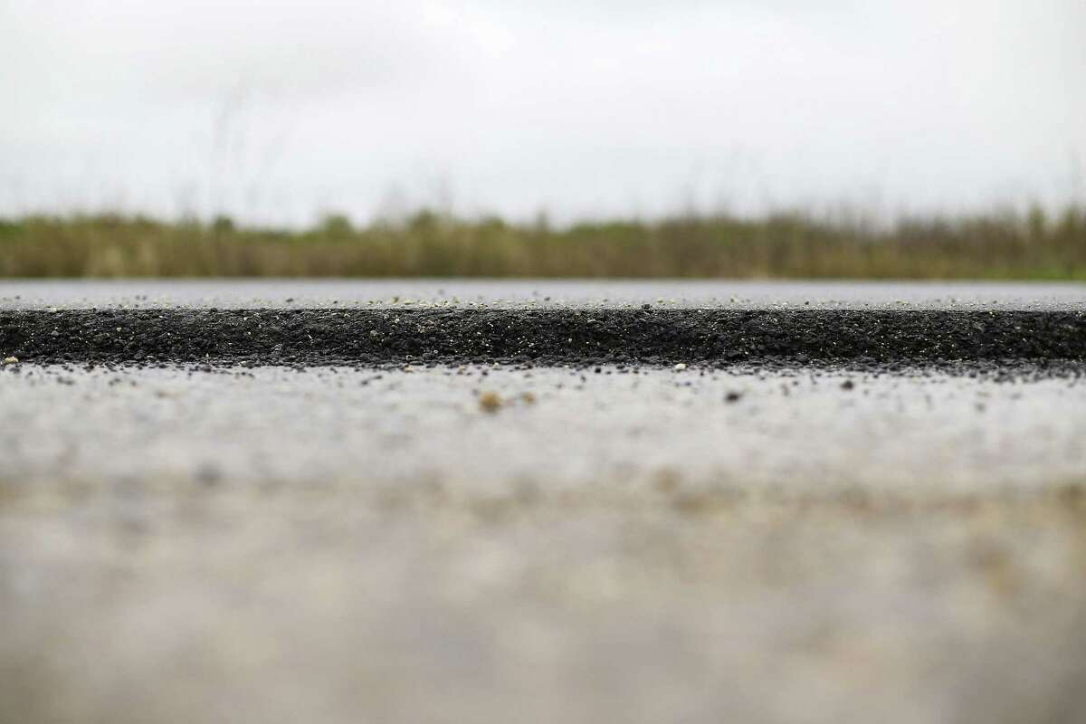 Gulfstream Road, a private road on Dow property in Lake Jackson is build using post-consumer recycled plastic as part of the asphalt mix, seen on March 7.
