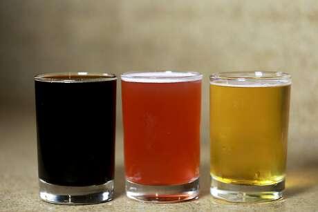 The Cellarmaker rainbow: Shrub Logix stout (left); Grape Shorty, a Syrah grape sour; and Mo' Simcoe IPA, all on tap. Photo: Yalonda M. James / The Chronicle