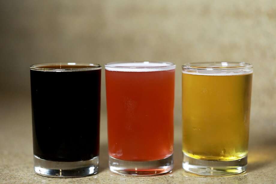 The Cellarmaker rainbow: Shrub Logix stout (left); Grape Shorty, a Syrah grape sour; and Mo' Simcoe IPA, all on tap. Photo: Yalonda M. James / The Chronicle