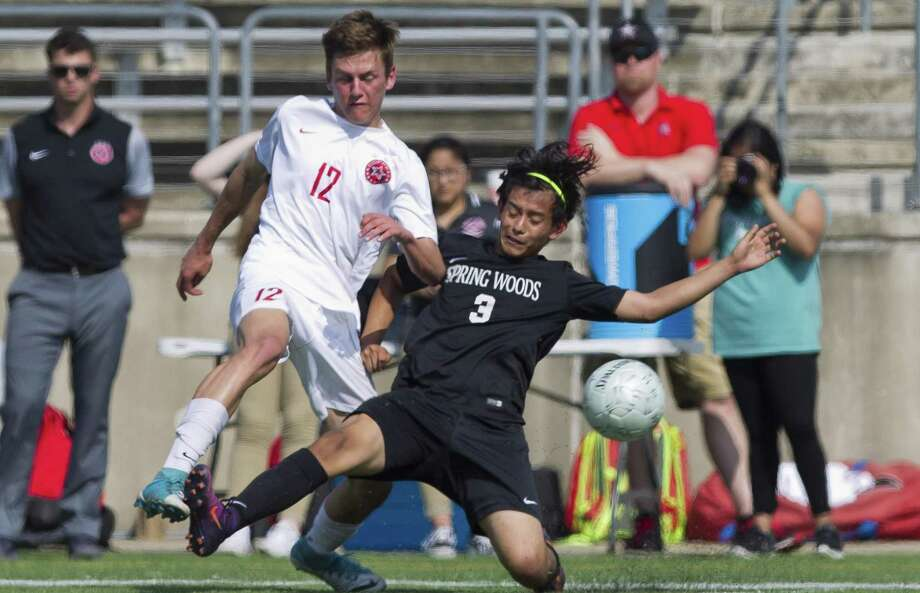 Spring Woods' Angel Originales (3) deflects the ball away from Coppell's Bennett Hunter (12) during the first period of a Region II-6A regional semifinal match at the Kelly Reeves Athletic Complex, April 13, 2018, in Round Rock. Photo: Jason Fochtman, Staff Photographer / Houston Chronicle / © 2018 Houston Chronicle