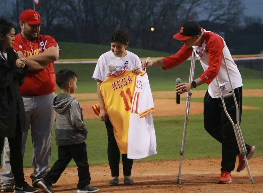 Stafford Municipal School District dedicated Michael Mesa Field on Feb. 16 at Stafford High School. The District retired Coach Mesa's Number 11 jersey and presented a jersey to his 5-year-old son, Leandro. The other Number 11 jersey will be proudly displayed inside the Stafford High School Competition Gym's trophy case. Photo: Stafford MSD Communications / Stafford MSD Communications