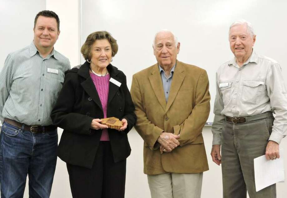 Bettegene Coyle was named Commissioner of the Year for 2018 at the Fort Bend County Historical Commission's Feb. 19 meeting in Richmond. Bettegene chairs the cemetery committee's records sub-committee, which submits cemetery reports and revisions to the Texas Historical Commission and maintains the active files of over 170 cemeteries both in the commission office and a duplicate at the George Memorial Library. To date, she has entered over 2,900 documents and photographs in her five years of work. From left are FBCHC Chairman Chris Godbold, Bettegene, husband Mat Coyle and cemetery committee chair Bob Crosser. Photo: David G. Rose / David G. Rose