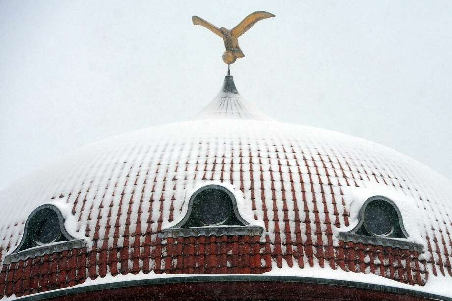 A light snow covers the dome on top of the Barnum Museum, in Bridgeport, Conn. March 2, 2019. Photo: Ned Gerard / Hearst Connecticut Media / Connecticut Post