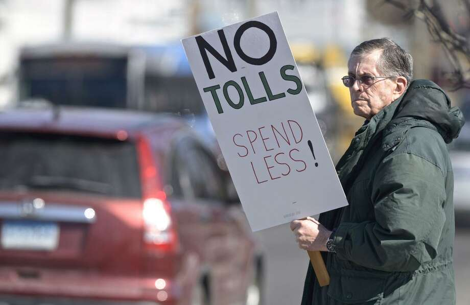 Harrison Pease, of Newtown, takes part in an anti-toll protest at the intersection of White and Wildman Streets on Saturday. The protest was organized by Stamford grassroots organization No Tolls Ct. March 9, 2019, in Danbury, Conn. Photo: H John Voorhees III / Hearst Connecticut Media / The News-Times
