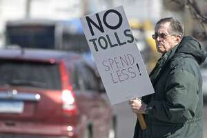 Harrison Pease, of Newtown, takes part in an anti-toll protest at the intersection of White and Wildman Streets on Saturday. The protest was organized by Stamford grassroots organization No Tolls Ct. March 9, 2019, in Danbury, Conn.