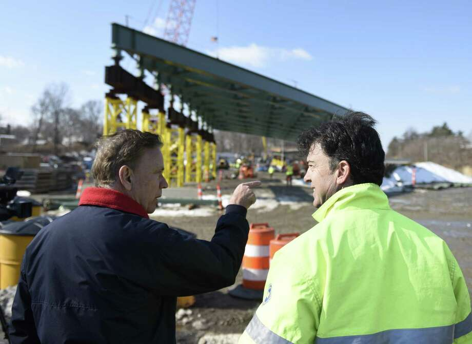 Connecticut Gov. Ned Lamont, left, chats with Department of Transportation Project Manager Louis Eveno about the new overpass being built spanning I-95's Exit 9 in Stamford, Conn. Monday, March 11, 2019. Connecticut Gov. Ned Lamont joined Stamford Mayor David Martin to talk about the replacement of the bridge that spans across I-95 at East Main Street and the importance of investing in the state's infrastructure. Photo: Tyler Sizemore / Hearst Connecticut Media / Greenwich Time