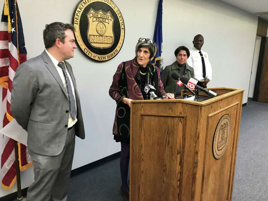U.S. Rep. Rosa DeLauro, D-3, speaks about appropriations to the Centers for Disease Control to research gun violence at the New Haven Police Headquarters, with University of New Haven Assistant Professor Karl Minges, Yale New Haven Hospital Injury Free Coalition for Kids co-principal investigator Kirsten Bechtel and Police Chief Anthony Campbell. Photo: Brian Zahn/Hearst Connecticut Media