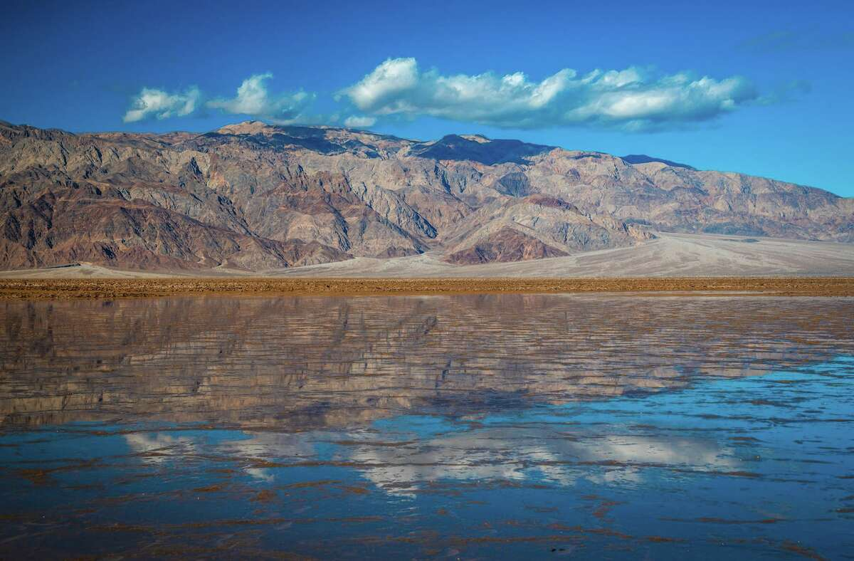 After a wet winter storm swept Death Valley National Park, a lake formed near Salt Creek. LA-based photographer Elliot McGucken captured photos of the water on March 7, 2019.