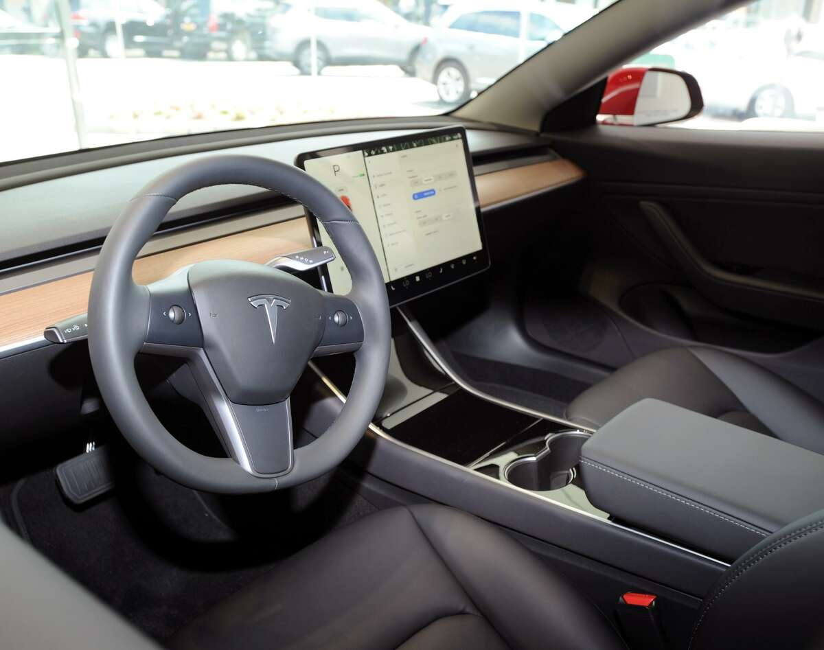 The steering-wheel and computer display of a Tesla Model 3 inside the Tesla gallery at 340 Greenwich Ave., Greenwich, Conn., on Friday, June 22, 2018.
