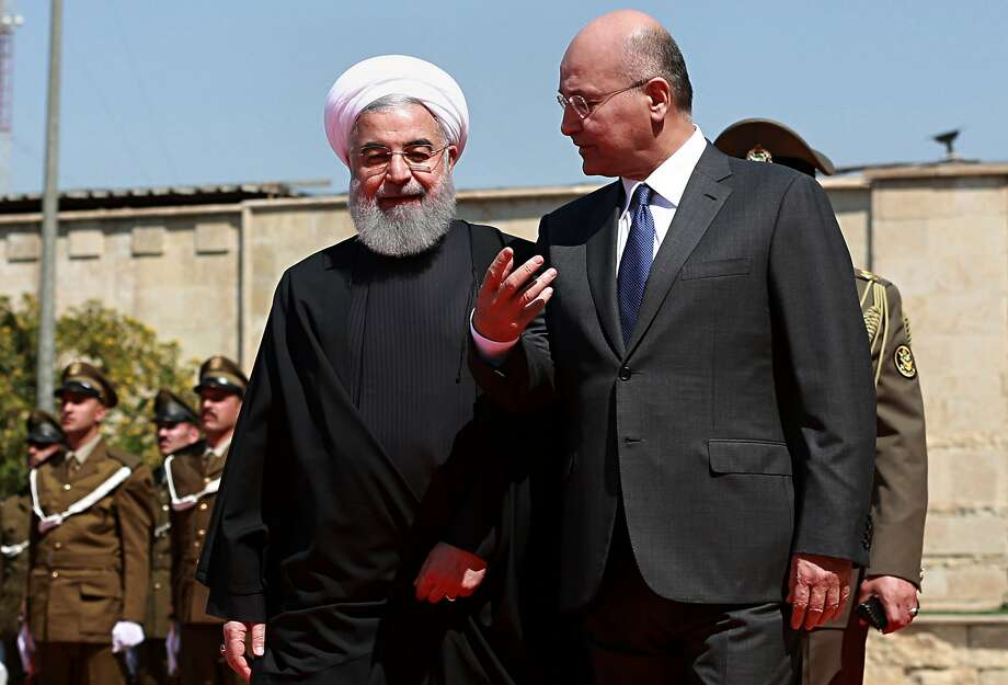 Iranian President Hassan Rouhani (left) is welcomed to Iraq by President Barham Salih. The two nations have built a close relationship since their bloody war in the 1980s. Photo: Khalid Mohammed / Associated Press