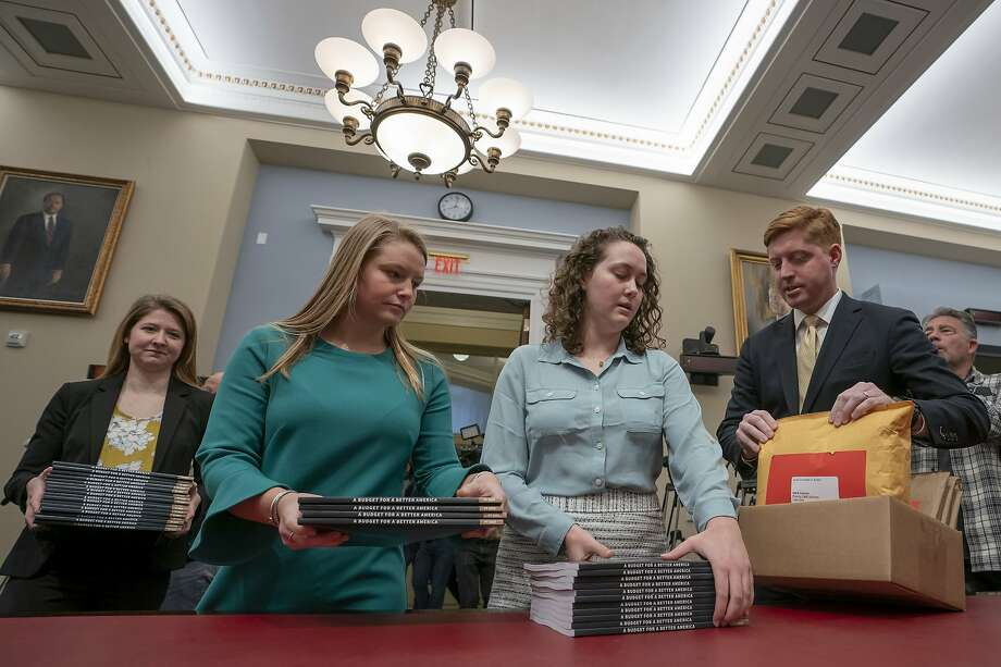 Office of Management and Budget staff deliver the president's budget to the House Budget Committee. The plan calls for sharp cuts in domestic programs. Photo: J. Scott Applewhite / Associated Press